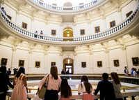 People look down from the balcony in the rotunda of the Texas State Capitol during the first day of the 85th Texas Legislative Session on Tuesday, January 10, 2017 at the Texas State Capitol in Austin, Texas. (Ashley Landis/The Dallas Morning News)