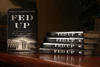 "Copies of Danielle DiMartino Booth's book ""Fed Up"" which was published by Portfolio Penguin and went on sale Tuesday. (Rose Baca/The Dallas Morning News)"