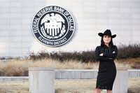Danielle DiMartino Booth had to make sure she didn't step on the property of the Federal Reserve Bank of Dallas to have this publicity photo taken.<div>(Howie Le)</div>