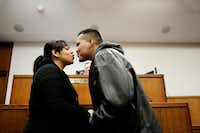 Lizette Torres (left) kisses Gonzalo Ramirez, both of Dallas, after they are married in the court room of judge Dale Tillery, of the 134th district court, on Valentine's Day in the George L. Allen, Sr. Courts Building in downtown Dallas Tuesday February 14, 2017. Torres and Ramirez have dated since they were teenagers, which has totaled a decade. (Andy Jacobsohn/The Dallas Morning News)