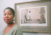 Ruby Bridges Hall poses Aug. 28, 1995, next to a print of the Norman Rockwell painting that depicts her first day in a New Orleans desegragated school. (AP Photo/Times Picayune, G. Andrew Boyd)(AP)