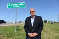 Mayor Jim Phaup stands at the Sunnyvale city limit sign off Highway 80. ((Rose Baca/The Dallas Morning News))