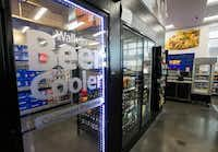 A walk-in beer cooler inside a new Walmart convenience store on Wednesday, February 8, 2017 on FM 1187 in Crowley, Texas. (Ashley Landis/The Dallas Morning News)(Staff Photographer)