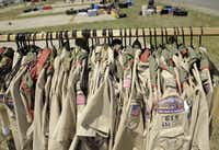 """Class A"" uniform shirts are hung neatly as Scouts erect their camps during the first day of the National Boy Scout Jamboree at Fort A.P Hill, Va.  (File Photo/The Free Lance-Star)"