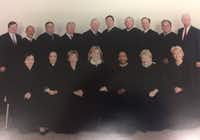 Dallas County's felony court judges, circa 2005. Faith Johnson is on the front row, third from the right. Former District Attorney Susan Hawk, who resigned three months ago, is in the front row, first from the right. John Creuzot, who's running as a Democrat for district attorney in 2018, is on the back row, second from the right.(Courtesy)
