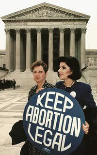"""Norma McCorvey (left) formally known as """"Jane Roe"""", with  attorney Gloria Allred in front of the U.S. Supreme Court in Washington, D.C.((1989 File Photo/AFP))"""