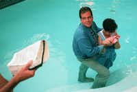 Flip Benham, director of Operation Rescue National, baptizes Norma  McCorvey , who was Roe in the Roe V. Wade case that  established abortion rights in the nation in a Garland swimming pool.((1995 File Photo/Louis DeLuca))