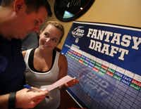 Top 100 ONLY  Evantage Inc president Chris Auwarter (left) makes his third round pick in the company Fantasy Football Draft at the Fox and Hound in Dallas as his wife wife Laura Auwater (right) coordinates. (Tom Fox/The Dallas Morning News)(Staff Photographer)