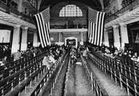 This 1924 file photo shows the registry room at Ellis Island in New York harbor, a gateway to America for millions of immigrants. (AP Photo/File)(AP)