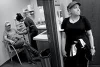 Weiss' wife, Marni, waits as her husband has blood drawn at Dr. Karen Fink's office at Baylor University Medical Center in Dallas. (Louis DeLuca/Staff Photographer)