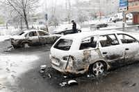 Several cars were torched during riots Monday in a Stockholm suburb known for its large immigrant population.((The Associated Press))