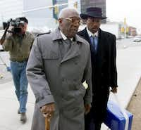 Former Dallas City Council member Al Lipscomb walks with John Wiley Price outside a federal courthouse in Amarillo in 2000 before he was found guilty of 65 counts of bribery. The conviction was later overturned.