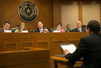 "<p></p><p></p><p>Texas protective services chief Henry ""Hank"" Whitman, right, shown testifying to the Senate panel on Feb. 2, has urged that the procurement method known as ""foster care redesign"" be up and running in 10 regions of the state by August 2019. (Ralph Barrera/Austin American-Statesman)</p><br><p></p><p></p>"