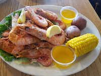 Royal reds, plump shrimp from the deep waters off the Alabama coast, are one of the area's dining stars. This plate's at King Neptune's Seafood Restaurant in Gulf Shores. ((Helen Anders))