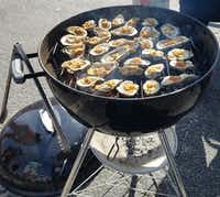 Oysters bubble on a grill during one of the many events at The Hangout, and indoor-outdoor bar and party space in Gulf Shores, Ala.((Helen Anders))