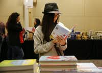 Daja Shelton, 13, of Granbury, checked out a book during the inaugural North Texas Teen Book Festival in 2015. (File Photo/Andy Jacobsohn) (<p><br></p><p></p>)