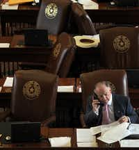 State representative Dan Flynn, R-Canton, works the phones during a break in the Sunday session for the 83rd Texas legislature at the State Capitol in Austin on Sunday, May 26, 2013. (Louis DeLuca/The Dallas Morning News)Staff Photographer