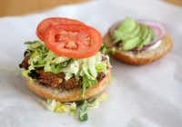 The Veggie-Bean-Quinoa Burger with avocado, romaine, tomato, red onion and buttermilk dressing at Start Restaurant.(Rose Baca/Staff Photographer)