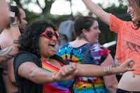 Ish Kundawala dances at a party to show support of the LGBTQ community gathered in front of the Governor's Mansion in Austin on Thursday, Feb. 23. (Stephen Spillman/Special Contributor)