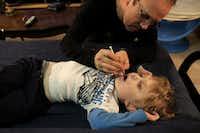 His father gives Elijah a cannabis oil extract.(Bonnie Jo Mount/Bonnie Jo Mount)