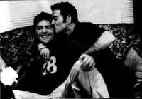 British pop superstar George Michael (right) kisses his Dallas partner Kenny Goss in an undated photograph from Goss' private collection(Kenny Goss' private collection)