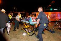 New Orleans emergency personnel attended to an injured parade watcher after a pickup truck plowed into a crowd on Saturday. (Scott Threlkeld/The Advocate)