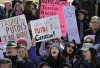 """Protesters hold placards and chant slogans during a demonstration called """"Emergency Rally to Stand for Democracy,"""" Sunday, Feb. 26, 2017, in Boston. Demonstrators called for an investigation into what they describe as the possible involvement of Russian officials in the campaign of then-presidential candidate Donald Trump in the Nov. 2016 election.(Steven Senne/AP)"""