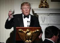 Host President Donald Trump, makes a toast during a dinner reception for the annual National Governors Association winter meeting Sunday, Feb. 26, 2017, at the State Dining Room of the White House, in Washington.(Manuel Balce Ceneta/AP)