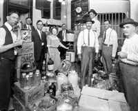 """<p>Law enforcement officers stand in a room containing confiscated bootleg liquor during Prohibition. Photo dated 1922.<span style=""""font-size: 1em; background-color: transparent;"""">From the collection of the Texas/Dallas History and Archives Division, Dallas Public Library.</span></p>"""
