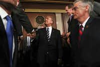 President Donald Trump shakes hands as he arrives on Capitol Hill in Washington, Tuesday, Feb. 28, 2017, for his address to a joint session of Congress. (Jim Lo Scalzo/Pool Image via AP)