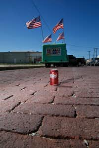 A discarded Dr Pepper can stands in the brick street near the Dublin Bottling Works in Dublin. Dublin Bottling Works no longer produces Dr Pepper. (Guy Reynolds/The Dallas Morning News)