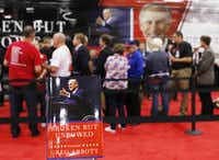 "Texas Attorney Greg Abbott signs his new book, ""Broken But Unbowed,"" during the 2016 Texas Republican Convention in May 2016 at the Kay Bailey Hutchison Convention Center in Dallas.2016 File Photo/David Woo"