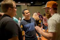 Nathan Hanks, CEO and co-founder of MAX (center), chats with fans at a private meet-and-greet at a Needtobreathe concert. MAX matched the Christian rock band to Dr. Pepper for ad campaigns. (Ting Shen/The Dallas Morning News)