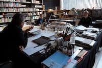 From left: Aranda, Pigem and Vilalta confer in their office in Olot. (Agence France-Presse)