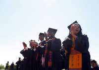Paul Quinn College graduating students celebrate during a commencement ceremony.((2013 File Photo/Staff))