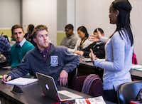 Duke University student Bryce McAteer (left) of Mission Viejo, Calif., listened to Paul Quinn College student Destiny Modeste of Brooklyn, N.Y., while they took a class from Duke doctoral student Danielle Purifoy at Paul Quinn College.((2015 File Photo/Ashley Landis))