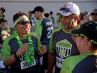 (From left) Frankie Lowe, her husband Robert Lowe and Susan Evans wait with other employees of Pioneer Natural Resources prepare for the start of the Corporate Challenge 5k Run in 2016 in Richardson, Texas. Pioneer was the No. 1 Large Company in 2016.(G.J. McCarthy/Staff Photographer)