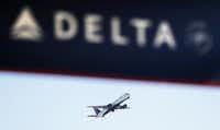 A Delta Air Lines flight takes off from Hartsfield-Jackson Atlanta International Airport in Atlanta, Monday, Jan. 30, 2017. Delta Air Lines, recovering from a weekend technology outage, canceled more flights Monday but said that the issue has been resolved. (AP Photo/David Goldman)AP
