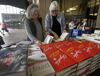 "Joyce Dorsey (left) and her friend Jen Carrick take a look at books at the the Wild Detectives Bookstore table during the 2016 Dallas Book Festival at J. Erik Jonsson Central Library. (<p><span style=""font-size: 1em; background-color: transparent;"">(Jae S. Lee/The Dallas Morning News)</span><br></p><p></p>)"