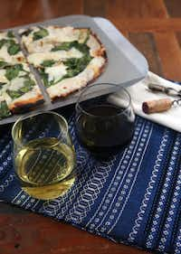 We worked to pair wines with a spinach and bufalina pizza from Olivella's.(Rose Baca/Staff Photographer)