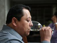 Sergio Quijano, sommelier at Nonna, drinks a white wine during a wine panel at the home of Tina Danze in Dallas.(Rose Baca/Staff Photographer)