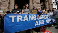 Members of the transgender community take part in a rally on the steps of the Texas Capitol, Monday, March 6, 2017, in Austin, Texas.  (AP Photo/Eric Gay)