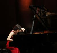 "<p><span style=""font-size: 1em; background-color: transparent;""></span></p><p><span style=""font-size: 1em; background-color: transparent;"">Claire Huangci performs during the preliminary round of the Van Cliburn International Piano Competition at Bass Performance Hall in Fort Worth in 2013.</span></p><p></p>(<p><span style=""font-size: 1em; background-color: transparent;"">(2013 File Photo/Staff/The Dallas Morning News)</span><br></p><p></p>)"