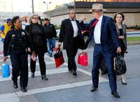 Dallas County Commissioner John Wiley Price (third from right) arrives with his lawyer Shirley Baccus-Lobel (second from left) and Dapheny Fain's lawyer Tom Mills (second from right) for the first day of their bribery trial at the Earle Cabell Federal Building and Courthouse in downtown Dallas, Thursday, February 23, 2017. (Tom Fox/The Dallas Morning News)(Staff Photographer)