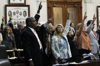 State Senator Wendy Davis, center, celebrates with colleagues as bedlam breaks out near midnight on the final day of the legislative special session, as the Senate considers an abortion bill, June 25, 2013, in Austin, Texas. (Louis DeLuca/Dallas Morning News/MCT)