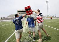 """<p>Eric Ramirez gets a Gatorade shower from s<span style=""""font-size: 1em; background-color: transparent;"""">eniors Joel Carlos (left) and Tyler Zych after a Hebron High win in April 2014.</span></p>((Ben Torres/Special Contributor))"""