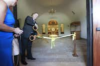 Paun Peters cut the ribbon at the opening of a Byzantine-style church building of St. John the Baptist Greek Orthodox Church in Euless in 2012. (File/Michael Ainsworth/The Dallas Morning News)
