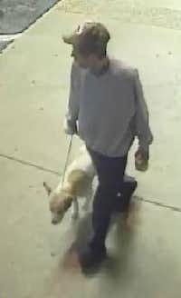 A surveillance video image of the man believed to have killed the dog.<br>(Irving Police Department<br>)