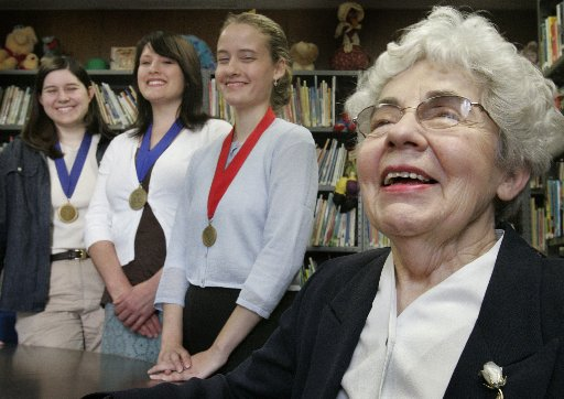 Friday, March 3, 2006    Dr. Cherie Clodfelter, Chairman of the University of Dallas Education Department teaches a class on child/young adult literature and holds a Clodecott Award Ceremony to honor the best books written by her students.  That year'ss winners of the Clodecott Award are (from left to right) Kelly Dupen, Sheila Waterman and Jennifer Zemenick.(100974)
