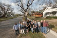 Residents who live in Garland's Travis College Hill district gather on the corner on Monday, March 6, 2017.  The one block street of Craftsman style houses has been approved for the National Register of Historic Places.   (Rex C. Curry/Special Contributor)